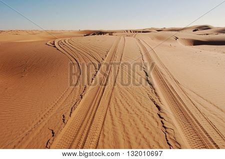 Tyre / Tire Tracks Through The Desert Sand Dunes and Fork in Path
