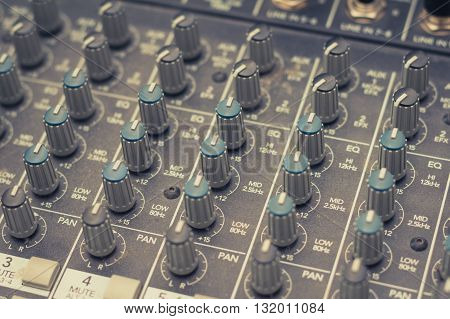 music mixer - studio equipment closeup -