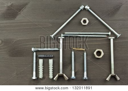 Building a house for the family. Needed for building. Building components. Screws and tools for building. Planning for the construction of the house. Model House of components.