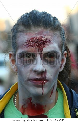 BELGRADE,SERBIA - OCTOBER 21: Woman with mask poses in Zombie walk within reeling of the Festival of Serbian fiction movies October 21 2012 in BelgradeSerbia
