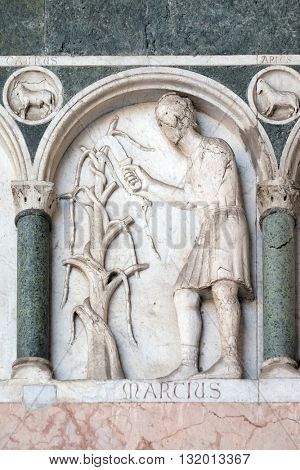 LUCCA, ITALY - JUNE 06, 2015: March, detail of the bas-relief representing the Labor of the months of the year, portal of the Cathedral of St Martin in Lucca, Italy, on June 06, 2015