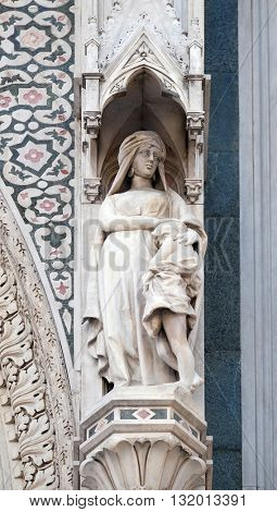 FLORENCE, ITALY - JUNE 05: Sarah and Isaac, Portal of Cattedrale di Santa Maria del Fiore (Cathedral of Saint Mary of the Flower), Florence, Italy on June 05, 2015