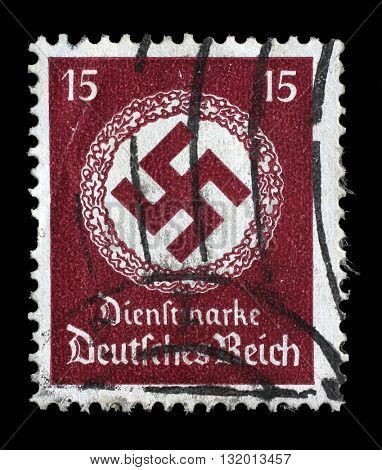 ZAGREB, CROATIA JUNE 22: A postage stamp printed in Germany shows the Swastika in an oak wreath, circa 1942, on June 22, 2014, Zagreb, Croatia
