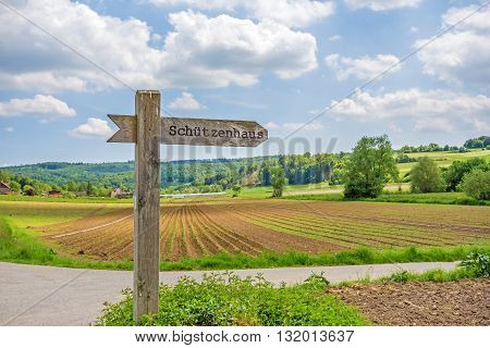 Signpost labeled with rifle association - rural landscape
