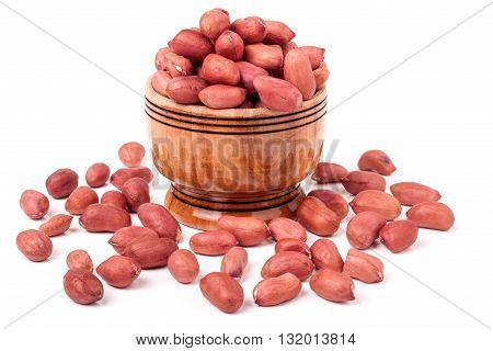 peeled peanuts in a wooden barrel on a white background.
