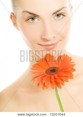 Beautiful young woman with gerber flower isolated on white background