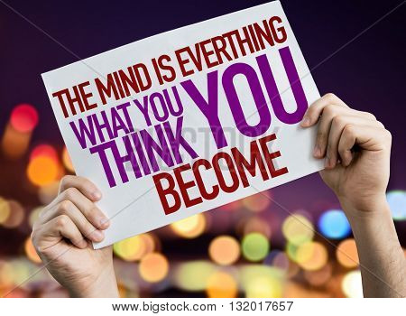 The Mind is Everything What You Think You Become placard with bokeh background