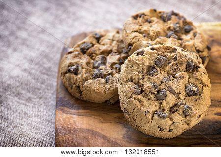 sweet chocolate american cookies on wooden table
