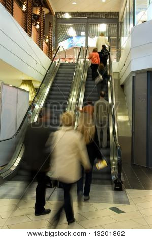 People on elevator in a shopping mall