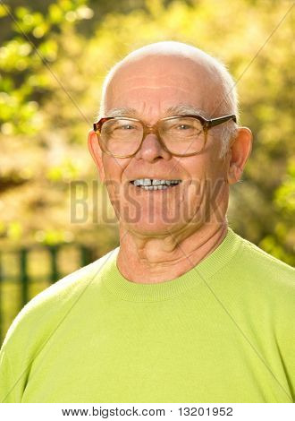 Happy elderly man outdoors
