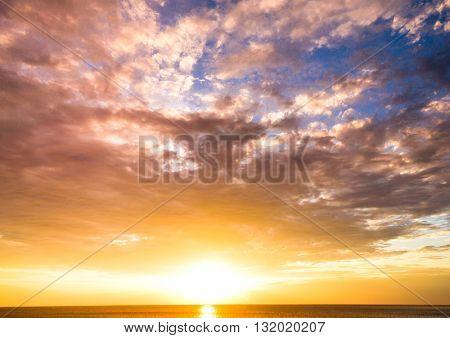 Fiery Sunrise Over Water