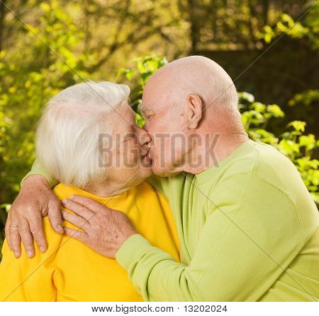 Kissing senior couple