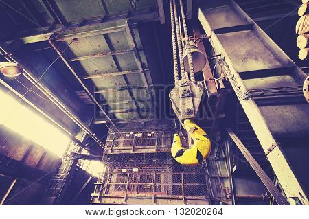 Vintage Toned Crane Hook In Abandoned Coal Mine.