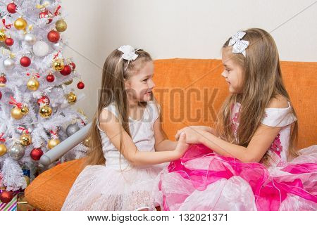 Two Girls In Beautiful Dresses Waiting Gift Joined Hands