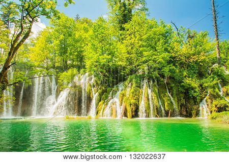 Beautiful landscape, waterfall and clear green water in the Plitvice Lakes National Park in Croatia. Beautiful world.