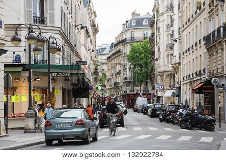 PARIS FRANCE - MAY 07 2015: Street in the historical centre of Paris the capital and most visited city of France