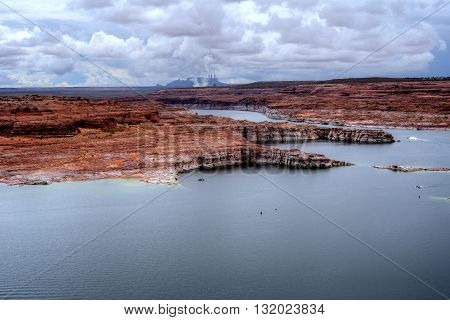 Elevated view Lake Powell in the Arizona Desert with distant power plant