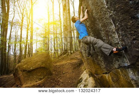 A Rock Climber Climbs Up The Mountain.