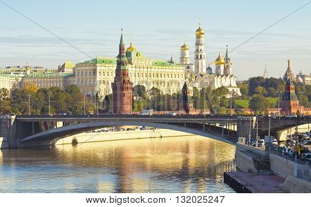 MOSCOW - SEPTEMBER 27 2013: Kremlin fortress with palace and cathedrals and Big Stone bridge on Moscow-river in Moscow Russia.