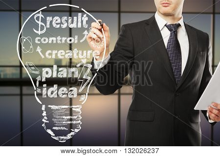 businessman drawing bulb and business concept close up