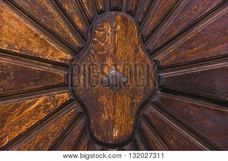 Part decorative old wooden door with a textured pattern