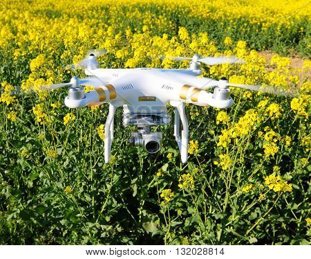 PILSEN CZECH REPUBLIC - APRIL 29, 2016: Drone quadrocopter Dji Phantom 3 Professional with camera. New tool for farmers use drones to inspect of cultivated fields. Modern technology in agriculture.