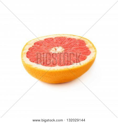 Single ripe fresh grapefruit cut in half isolated over the white background
