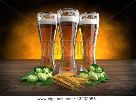 three glasses of beer with barley and hops on wooden desk - 3D render