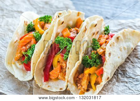 Chicken tacos on the baking paper close up