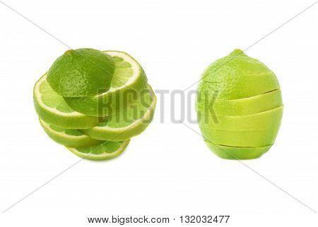 Fresh green lime cut in slices isolated over the white background, set of different foreshortenings