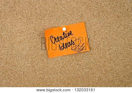 Creative Ideas Written On Orange Paper Note