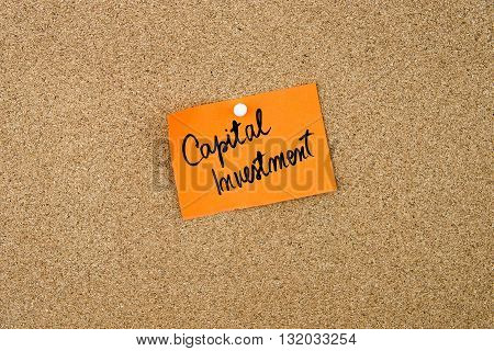 Capital Investment Written On Orange Paper Note