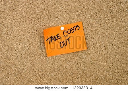 Take Costs Out Written On Orange Paper Note
