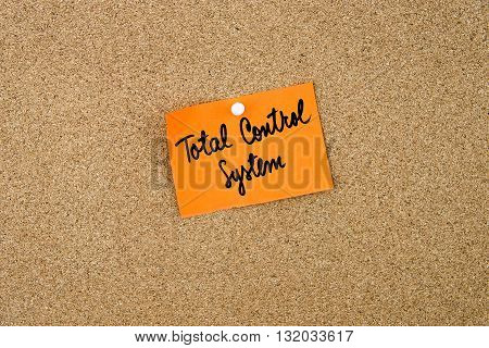 Total Control System Written On Orange Paper Note