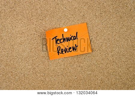 Technical Review Written On Orange Paper Note