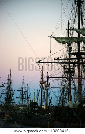 SAN DIEGO, UNITED STATES - DECEMBER 25: Old sailing ships of the Maritime Museum of San Diego are in the sunrise of December 25, 2015 in the port of San Diego.