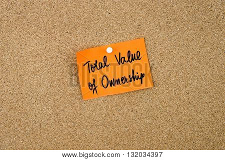 Total Value Of Ownership Written On Orange Paper Note