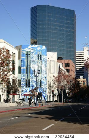 SAN DIEGO, UNITED STATES - DECEMBER 25: The art installation of the exhibition Rethink on a facade behind the skyline of San Diego on December 25, 2015 in San Diego.