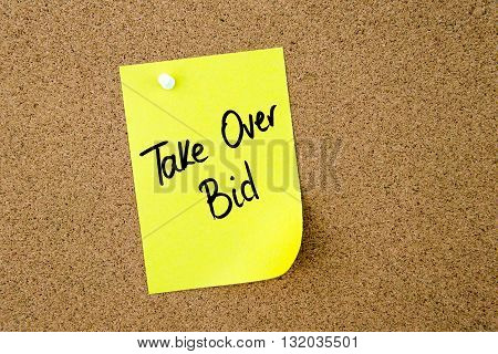 Take Over Bid Written On Yellow Paper Note
