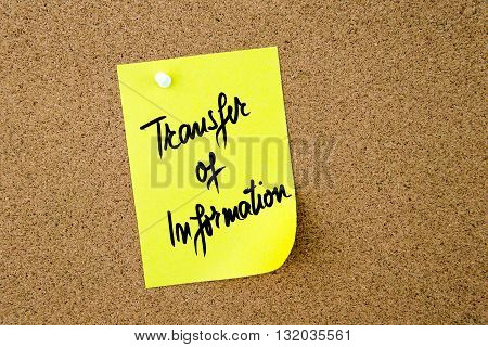 Transfer Of Information Written On Yellow Paper Note