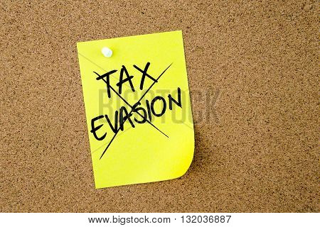 Tax Evasion Crossed Out Written On Yellow Paper Note