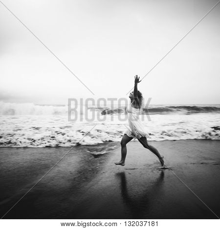 Young Woman Arms Raised Happiness Beach Concept