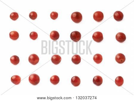 Set of multiple single dark red grapes isolated over the white background