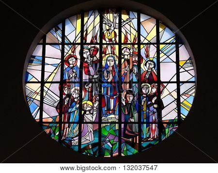 KLEINOSTHEIM, GERMANY - JUNE 08: Pentecost, stained glass window in the Saint Lawrence church in Kleinostheim, Germany on June 08, 2015