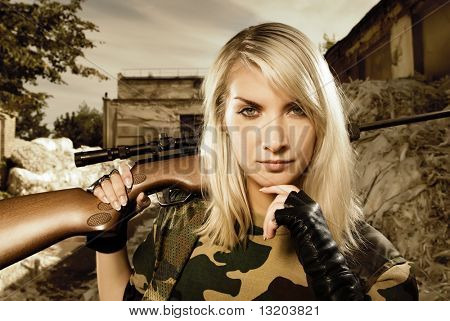 Beautiful woman soldier with a sniper rifle