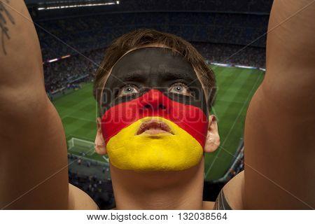 German fans at the stadium. Football, soccer fan. Stadium background