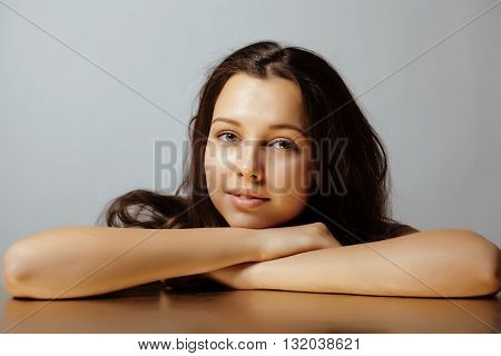 beauty young teenage cute brunette real girl smiling close up on grey background, lifestyle people concept