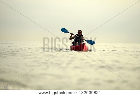 Young woman kayaking in ocean off of Florida