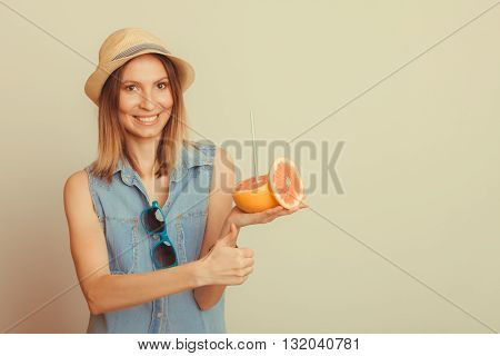 Glad Woman In Hat With Sunglasses And Grapefruit