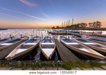 Rental Boats In A Marina At Sunrise